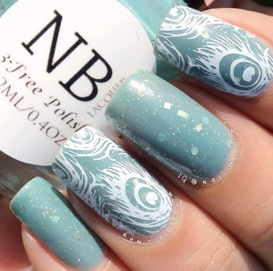 Stamped peacock feathers on top of 'Antique Blue' by NB Lacquer.